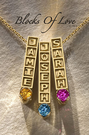 Custom made mother's jewelry pendants with raised lettering and genuine birthstones.