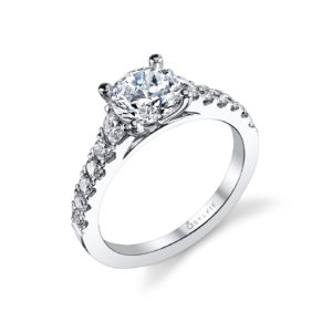 A classic four prong engagement ring style featuring descending round brilliant cut accent stones