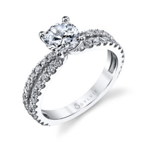 Classic four prong diamond engagement ring with a split shank