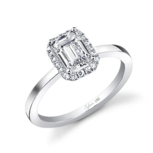 Simple halo style diamond engagement ring with an emerald cut center stone