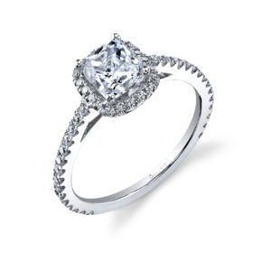 Halo style, cushion cut diamond engagement ring with a single row of accent diamonds