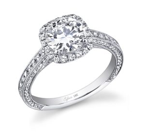 halo style diamond engagement ring with milgrain accents and vintage styling