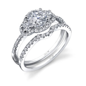 Three stone diamond engagement ring with a simple halo styling