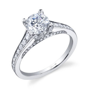 Four prong diamond engagement ring with tapered diamond accented shank