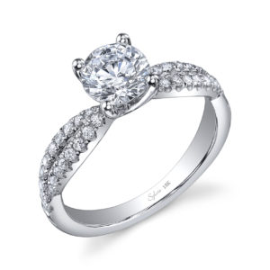 Four prong diamond engagement ring with criss-crossing diamond band