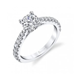 Classic four prong diamond engagement ring with a single row of round brilliant accent stones