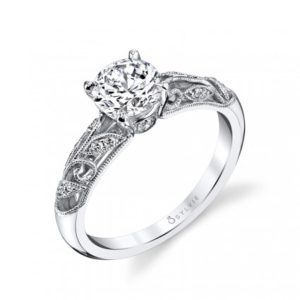Vintage styled diamond engagement ring with a floral milgrain accented shank