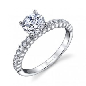Four prong diamond engagement ring with milgrain accented bezel set accent stones