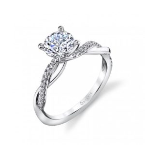 Four prong diamond engagement ring with a twisting diamond and gold shank