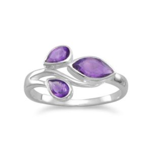 two pear shape and one marquise cut amethyst flow on this sterling silver ring