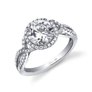 Halo style diamond engagement ring with a twisted shank crossing over itself