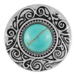 This snap by Ginger Snaps© exhibits a turquoise stone in the middle of an ornate silver design