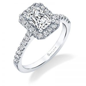 Classic halo style engagement ring with emerald cut center diamond