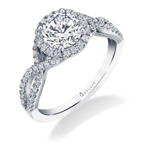 Halo style diamond engagement ring with an open, twisting shank