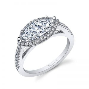 Unique halo style engagement ring with a marquise cut diamond