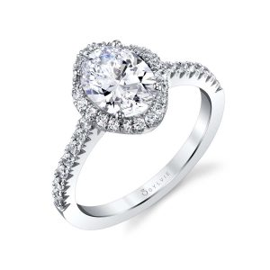 Classic halo style engagement ring with oval cut center diamond