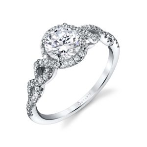 Modern halo style engagement ring with a twisting shank