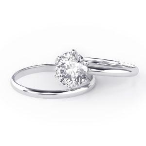 Freshly rhodium plated white gold engagement ring and wedding band