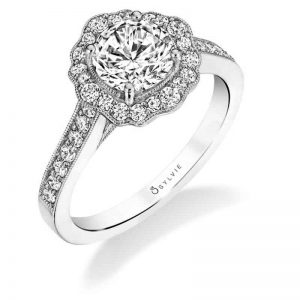 A white gold diamond engagement ring from the Sylvie Collection featuring a floral milgrain accented halo
