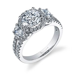 A white gold three stone, halo engagement ring from the Sylvie Collection with half-moon shaped diamonds