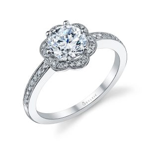 A white gold diamond engagement ring featuring a milgrain accented floral shaped halo