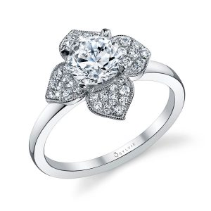 A white gold diamond engagement ring from the Sylvie Collection featuring four diamond studded petals