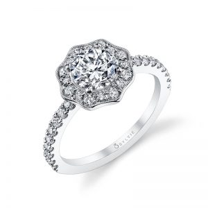 A white gold diamond engagement ring from the Sylvie Collection featuring a floral themed milgrain accented halo mounting