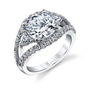 A white gold diamond engagement ring from the Sylvie Collection featuring a large round diamond with triangle cut diamonds on either side