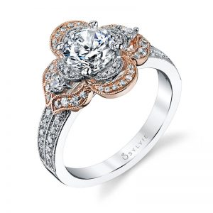 """A floral themed white and rose gold diamond engagement ring from the Sylvie Collection with """"petals"""" set with diamonds around a round diamond"""