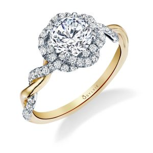 A two-tone white and yellow gold diamond engagement ring from the Sylvie Collection featuring a twisting diamond shank and halo