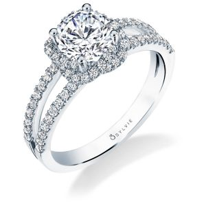 A white gold diamond engagement ring from the Sylvie Collection featuring a twisting halo type design with a split shank