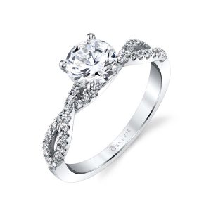 A white gold diamond engagement ring from the Sylvie Collection featuring a twisting diamond shank and round diamond