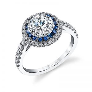 A white gold diamond engagement ring from the Sylvie Collection featuring a round center diamond with a double halo mounting using sapphires in one and diamonds in the other