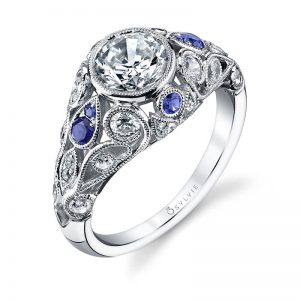 A white gold diamond and sapphire engagement ring from the Sylvie Collection