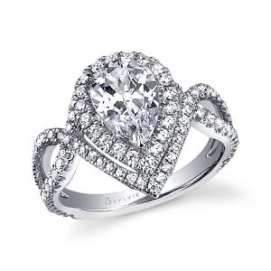 A white gold diamond engagement ring from the Sylvie Collection with a pear shaped diamond in the center