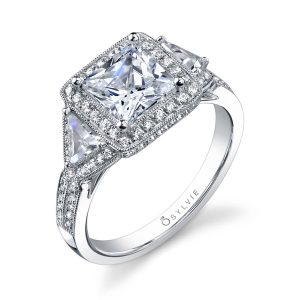 White gold diamond engagement ring featuring a large princess cut diamond with a halo and two accompanying triangle cut diamonds from the Sylvie Collection