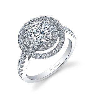 A white gold double halo diamond engagement ring from the Sylvie Collection featuring a prominent center diamond