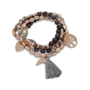 champagne and gold tone set of four stretch bracelets with tassels and charms